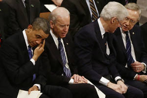 Photo - President Barack Obama wipes his eye as he is seated with Vice President Joe Biden, former President Bill Clinton, and Senate Majority Leader Harry Reid at the funeral service for the late Sen. Daniel Inouye, D-Hawaii, at the Washington National Cathedral, Friday, Dec. 21, 2012. (AP Photo/Charles Dharapak)
