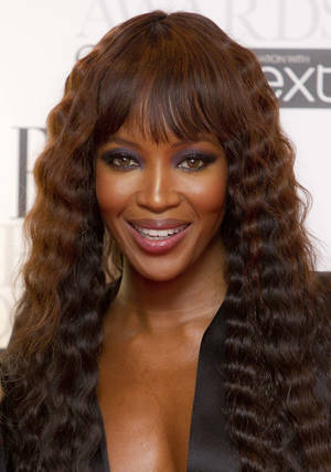 Photo -   FILE - In this Feb. 13, 2012 file photo, Naomi Campbell poses in the press room for the Elle Style Awards at the Savoy hotel in London. Campbell and a perfume company have settled a sour dispute that started over a fragrance line and became part of the backdrop of former Liberian President Charles Taylor's war crimes trial. Dueling lawsuits between the supermodel and an entity called Moodform Mission were closed Thursday, June 28, 2012, Manhattan court records show. (AP Photo/Joel Ryan, File)