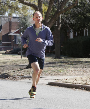 Photo -  David Sooter runs through a neighborhood near his house in Oklahoma City. Sooter runs a number of long distance races throughout the country. Photo by Paul Hellstern, THE OKLAHOMAN  <strong>PAUL HELLSTERN -  Oklahoman </strong>