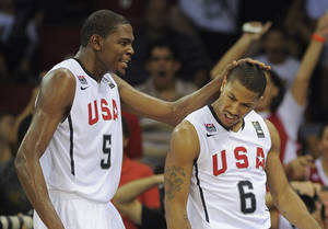 Photo - U.S. / UNITED STATES BASKETBALL TEAM: USA's Kevin Durant, left, congratulates Derrick Rose after scoring during the preliminary round of the World Basketball Championship, Monday, Aug. 30, 2010, in Istanbul, Turkey.  (AP Photo/Mark J. Terrill) ORG XMIT: ISMT130