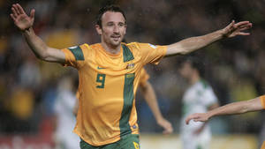 Photo - Australia's Josh Kennedy celebrates after scoring against Iraq during their World Cup soccer Asian qualifying match at the Sydney Olympic Stadium in Sydney, Australia, Tuesday, June 18, 2013. Australia won the match 1-0 and qualify for the 2014 World Cup in Brazil. (AP Photo/Rick Rycroft)