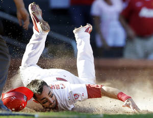 photo -   St. Louis Cardinals&#039; Matt Carpenter scores the game-winning run on a single by Allen Craig during the 10th inning of a baseball game against the Milwaukee Brewers, Sunday, Sept. 9, 2012, in St. Louis. The Cardinals won 5-4. (AP Photo/Jeff Roberson)  