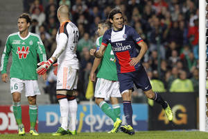 Photo - Paris Saint Germain's Edinson Roberto Cavani, right, celebrates after a goal against Saint-Etienne during their French League One soccer match in Saint-Etienne, central France, Sunday, Oct. 27, 2013. (AP Photo/Laurent Cipriani)