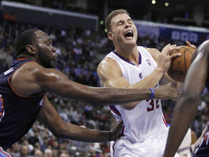 Photo - Los Angeles Clippers forward Blake Griffin, right, pulls up to shoot as Charlotte Bobcats center Al Jefferson, left, defends during the first half of an NBA basketball game Wednesday, Jan. 1, 2014, in Los Angeles. (AP Photo/Alex Gallardo)