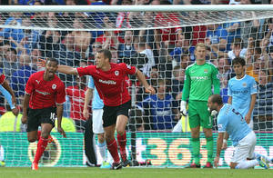 Photo - Cardiff City's Fraizer Campbell, far left, celebrates scoring his side's third goal of the game during their English Premier League match against Manchester City at Cardiff City Stadium, Cardiff, Wales, Sunday Aug. 25, 2013. (AP Photo/PA, Nick Potts)  UNITED KINGDOM OUT  NO SALES  NO ARCHIVE
