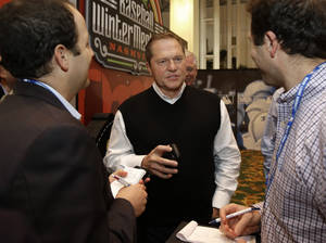photo - Sports agent Scott Boras, center, talks with reporters at the baseball winter meetings on Wednesday, Dec. 5, 2012, in Nashville, Tenn. (AP Photo/Mark Humphrey)