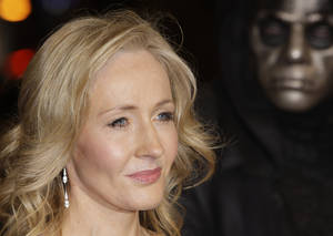 """Photo -   FILE - A Thursday, Nov. 11, 2010 photo from files showing British author J K Rowling arriving at a cinema in London's Leicester Square for the World Premiere of Harry Potter and the Deathly Hallows Part 1. She may not be able to match the phenomenal success of the Harry Potter series, but J.K. Rowling has high hopes for """"The Casual Vacancy,"""" her first novel for adults. The title was announced Thursday, April 12, 2012, by Little, Brown & Co. along with a brief plot synopsis for the book.The publisher said it will be available worldwide on Sept. 27. (AP Photo/Joel Ryan, File)"""