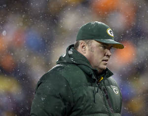 Photo - Green Bay Packers head coach Mike McCarthy walks off the field after an NFL football game against the Pittsburgh Steelers Sunday, Dec. 22, 2013, in Green Bay, Wis. The Steelers won 38-31. (AP Photo/Jeffrey Phelps)