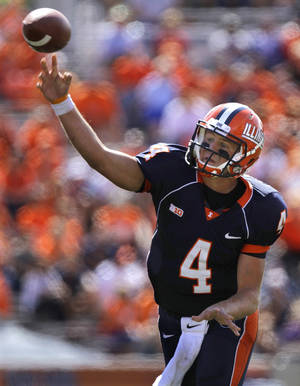 Photo -   Illinois quarterback Reilly O'Toole (4) passes the ball during the first half of the NCAA college football game against Charleston Southern, Saturday, Sept. 15, 2012 in Champaign, Ill. (AP Photo/Seth Perlman)