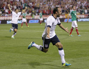 Photo - United States' Landon Donovan celebrates his goal against Mexico during the second half of a World Cup qualifying soccer match Tuesday, Sept. 10, 2013, in Columbus, Ohio. The United States defeated Mexico 2-0. (AP Photo/Jay LaPrete)