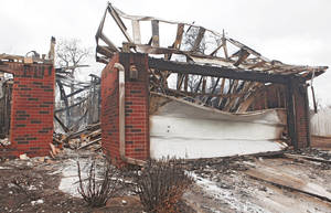 photo - This house in Midwest City was destroyed Thursday by wildfires in the area.  PHOTO BY CHRIS LANDSBERGER, THE OKLAHOMAN
