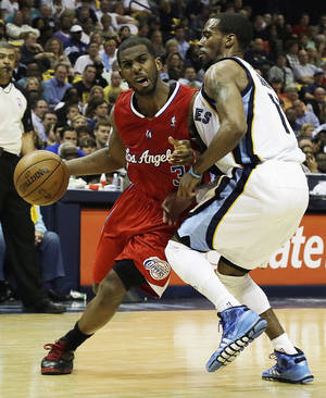 Photo - Los Angeles Clippers' Chris Paul, (3) left, moves against Memphis Grizzlies' Mike Conley during the first half of Game 3 in a first-round NBA basketball playoff series, in Memphis, Tenn., Thursday, April 25, 2013. (AP Photo/Danny Johnston) ORG XMIT: TNDJ104