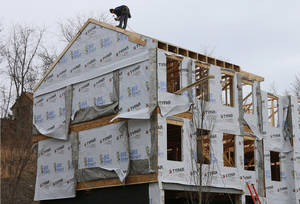 Photo - In this Monday, Jan. 13, 2014, photo, a carpenter works on the roof of a town home  in Robinson Township, Pa. The National Association of Home Builders releases the housing market index for January on Thursday, Jan. 16, 2014. (AP Photo/Gene J. Puskar)