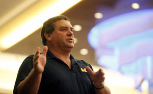 photo - Michigan football coach Brady Hoke speaks at the Michigan High School Football Coaches Associations' Winner's Circle clinic, Friday, Jan. 18, 2013, at the Radisson Plaza Hotel in downtown Kalamazoo, Mich. (AP Photo/Kalamazoo Gazette-MLive Media Group, Mark Bugnaski) ALL LOCAL TV OUT; INTERNET OUT