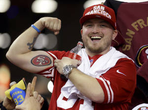 Photo - A San Francisco 49ers fan shows off his tattoo  after the NFL football NFC Championship game against the Atlanta Falcons Sunday, Jan. 20, 2013, in Atlanta. The 49ers won 28-24 to advance to Super Bowl XLVII. (AP Photo/Mark Humphrey)