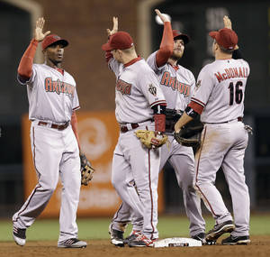 Photo -   Arizona Diamondbacks', from left, Justin Upton, Aaron Hill, Jason Kubel and John McDonald celebrate a 8-6 win over the San Francisco Giants during a baseball game on, Tuesday, Sept. 4, 2012 in San Francisco. (AP Photo/Marcio Jose Sanchez)