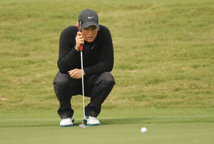 Photo - Suzann Pettersen of Norway, lines up her putt on the 1st hole green during the second round of the Sunrise LPGA Taiwan Championship tournament at the Sunrise Golf & Country Club, Friday, Oct. 25, 2013, in Yangmei, north eastern Taiwan. (AP Photo/Wally Santana)