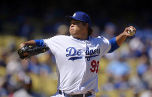 Photo - Los Angeles Dodgers starting pitcher Ryu Hyun-Jin, of South Korea, throws to the plate during the first inning of the Dodgers' baseball game against the Colorado Rockies, Sunday, Sept. 29, 2013, in Los Angeles. (AP Photo/Mark J. Terrill)