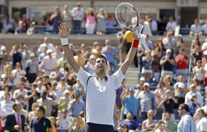 Photo -   Novak Djokovic of Serbia reacts after beating Spain's David Ferrer during a semifinal match at the 2012 US Open tennis tournament, Sunday, Sept. 9, 2012, in New York. (AP Photo/Mike Groll)