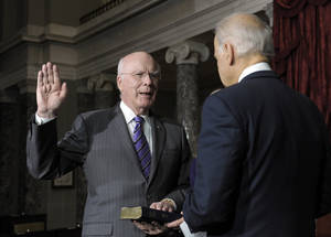 photo - Vice President Joe Biden, right, reenacts the swearing in of Sen. Patrick Leahy, D-Vt., as President Pro Tempore of the Senate in the Old Senate Chamber on Capitol Hill in Washington, Tuesday, Dec. 18, 2012. (AP Photo/Susan Walsh)