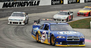 Photo -   Brad Keselowski (2) makes his way through the first turn during NASCAR's Sprint Cup Series auto race at Martinsville Speedway, Sunday, Oct. 28, 2012, in Martinsville, Va. (AP Photo/Don Petersen)