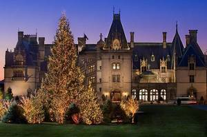 The Biltmore House glows during Candlelight Christmas Evenings. Provided by the Biltmore Estate. <strong></strong>
