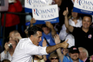 Photo -   Republican presidential candidate, former Massachusetts Gov. Mitt Romney gives a thumbs up to someone in the crowd after speaking at a campaign event at the Wings Over the Rockies Air and Space Museum, Monday, Oct. 1, 2012, in Denver. (AP Photo/David Goldman)