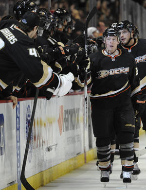 Photo -   Anaheim Ducks left wing Jason Blake (33) is congratulated by teammates after scoring a goal against the Anaheim Ducks in the period of an NHL hockey game in Anaheim, Calif., Monday, March 5, 2012. (AP Photo/Lori Shepler)
