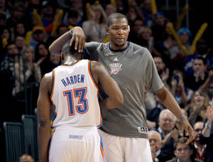 Photo - CELEBRATION: Oklahoma City Thunder's Kevin Durant (35) celebrates with Oklahoma City Thunder's James Harden (13) during the NBA basketball game between the Oklahoma City Thunder and the San Antonio Spurs at the Chesapeake Energy Arena in Oklahoma City, Sunday, Jan. 8, 2012. Photo by Sarah Phipps, The Oklahoman