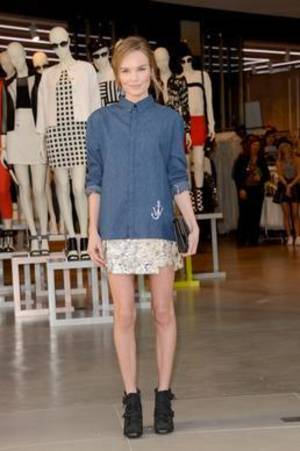 Photo - For the Topshop store opening on Feb. 14, in Los Angeles, Kate Bosworth — the celebrity face for the brand — browsed in a J.W. Anderson for Topshop denim shirt with no pockets, a Topshop floral print mini, high-top wedges and the Proenza Schouler PS1 clutch.