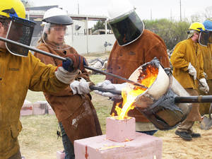 Photo - University of Oklahoma students participate in last year's iron pour on campus. PHOTO PROVIDED BY OU