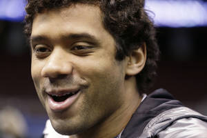 Photo - Seattle Seahawks' Russell Wilson answers a question during media day for the NFL Super Bowl XLVIII football game Tuesday, Jan. 28, 2014, in Newark, N.J. (AP Photo/Mark Humphrey)