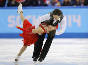 Photo - Cathy Reed and Chris Reed of Japan compete in the team ice dance short dance figure skating competition at the Iceberg Skating Palace during the 2014 Winter Olympics, Saturday, Feb. 8, 2014, in Sochi, Russia. (AP Photo/Vadim Ghirda)