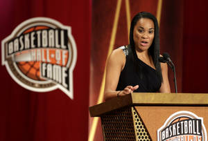 Photo - Inductee Dawn Staley speaks during the enshrinement ceremony for this year's class of the Basketball Hall of Fame, at Symphony Hall in Springfield, Mass., Sunday, Sept. 8, 2013. (AP Photo/Steven Senne)