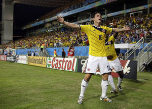 Photo - Colombia's James Rodriguez celebrates after scoring during the group C World Cup soccer match between Japan and Colombia at the Arena Pantanal in Cuiaba, Brazil, Tuesday, June 24, 2014. (AP Photo/Felipe Dana)