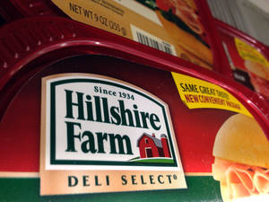Photo - Packages of Hillshire Farm deli meat are displayed at a supermarket in Middleton, Mass., Monday, June 9, 2014. Tyson Foods Inc. has won a bidding war for Hillshire Brands, the maker of Jimmy Dean sausages and Ball Park hot dogs, with a $63 per share offer. (AP Photo/Elise Amendola)