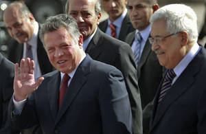 photo - King Abdullah II of Jordan, left, gestures during a welcoming ceremony with Palestinian President Mahmoud Abbas, prior to their meeting in the West Bank city of Ramallah, Thursday, Dec. 6, 2012. Jordans King Abdullah II has begun a brief visit to the West Bank in support of Palestinian President Mahmoud Abbas successful bid for U.N. recognition of a state of Palestine. (AP Photo/Majdi Mohammed)