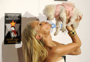 Host Kristin Chenoweth lifts up her dog for a kiss at the Hero Dog Awards. AP Photo