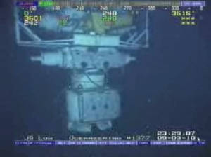 Photo - In this image taken from video provided by BP  PLC at 12:23 a.m. EDT, Saturday Sept. 4, 2010 Aug. 3, 2010 shows the blowout preventer that failed to stop oil from spewing into the Gulf of Mexico being raised to the surface. The last-ditch safety device that didn't stop the 2010 BP oil spill had multiple failures, wasn't tested properly, and still poses a risk for many rigs drilling today, another federal investigation board concludes. The report issued Thursday by the U.S. Chemical Safety Board zeroes in on what went wrong with the blowout preventer and blames bad management and operations. They found two different sets of wrong wiring, a dead battery and a bent pipe in the hulking failsafe device. And that they said led to the dumping of 172 million gallons of oil into the Gulf of Mexico. (AP Photo/BP PLC) NO SALES