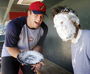 Photo -  Kevin Richardson, left, laughs after demonstrating his pie-in-the face technique on fellow RedHawk Royce Huffman. Photo by Nate Billings, The Oklahoman