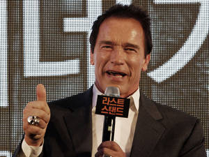 "Photo - Actor Arnold Schwarzenegger gestures during a press conference to promote his latest film ""The Last Stand"" in Seoul, South Korea, Wednesday, Feb. 20, 2013. The movie will open on Thursday, Feb. 21, in South Korea.  (AP Photo Ahn Young-joon)"