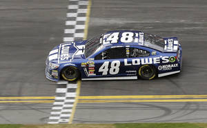 Photo - Jimmie Johnson crosses the finish line to win the Daytona 500 NASCAR Sprint Cup Series auto race, Sunday, Feb. 24, 2013, at Daytona International Speedway in Daytona Beach, Fla. (AP Photo/Chris O'Meara)