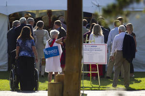 Photo -   People line up for a fundraiser for Republican presidential candidate, former Massachusetts Gov. Mitt Romney hosted by former Vice President Dick Cheney on Thursday, July 12, 2012 in Wilson, Wyo. (AP Photo/Evan Vucci)