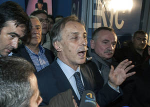 Photo - Presidential candidate Miodrag Lekic addresses his supporters after his headquarters claimed victory in Podgorica, Montenegro, Sunday, April 7, 2013. Both the incumbent and the opposition candidate claimed victory in Montenegro's presidential election on Sunday, fueling political tensions in the small Balkan country which is striving for European Union membership. State election authorities had yet to release any official results in the race for the largely ceremonial post. President Filip Vujanovic, from the ruling Democratic Party of Socialists, said that based on his camp's own, full count of the votes, he had won 51.3 percent of ballots, while opponent Lekic won 48.7 percent. (AP Photo/Risto Bozovic)
