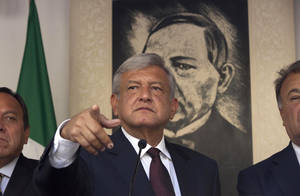 Photo -   Andres Manuel Lopez Obrador, presidential candidate for the Democratic Revolution Party (PRD), speaks during a news conference in Mexico City, Friday, July 06, 2012. The official count in Mexico's presidential election concluded Friday with results showing that presidential candidate Enrique Pena Nieto of the Institutional Revolutionary Party, or PRI, got about 3.3 million more votes than his closest rival, Lopez Obrador, giving him a 6.6 percent lead in the former ruling party's bid to regain power. Lopez Obrador said Friday he will challenge the results.(AP Photo/Alexandre Meneghini)
