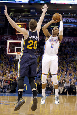 Photo - Oklahoma City 's Caron Butler (2) shoots over Utah's Gordon Hayward during the NBA game between the Oklahoma City Thunder and the Utah Jazz at the Chesapeake Energy Arena, Sunday, March 30, 2014, in Oklahoma City. Photo by Sarah Phipps, The Oklahoman
