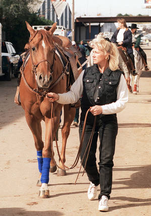 Photo - Rita Crundwell, of Dixon, Ill., is seen at the 1996 American Quarter Horse Association World Championship at State Fair Park in Oklahoma City.  PHOTO BY PAUL B. SOUTHERLAND, THE OKLAHOMAN ARCHIVES