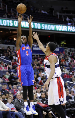 Photo - Detroit Pistons guard Rodney Stuckey takes a shot against Washington Wizards guard Shaun Livingston, right, during the first half of an NBA basketball game, Saturday, Dec. 22, 2012, in Washington. (AP Photo/Nick Wass)