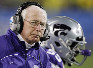Photo - Kansas State head coach Bill Snyder looks away during the second half of the Fiesta Bowl NCAA college football game against Oregon, Thursday, Jan. 3, 2013, in Glendale, Ariz. (AP Photo/Paul Connors) ORG XMIT: PNP145