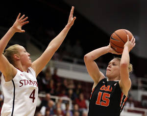 Photo - Oregon State's Jamie Weisner, right, shoots against Stanford's Taylor Greenfield (4) during the first half of an NCAA college basketball game Sunday, Jan. 5, 2014, in Stanford, Calif. (AP Photo/Ben Margot)